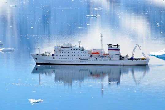 An Antarctic cruise ship waiting in Paradise Harbour for tourists ashore on an expedition