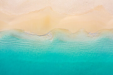 Summer seascape beautiful waves, blue sea water in sunny day. Top view from drone. Sea aerial view, amazing tropical nature background. Beautiful bright sea with waves splashing and beach sand concept Fototapete