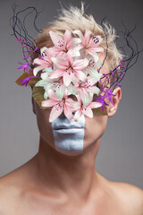 Abstract art collage of young man with flowers bouquet