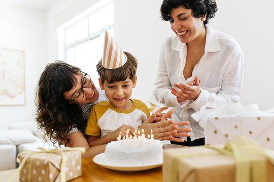 Lesbian parents celebrating boy's birthday