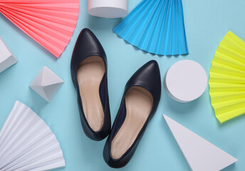 Leather shoes with heels on abstract background with geometric shapes. Minimalism. Concept art. Creative layout
