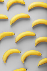 Bright pattern of yellow bananas on a gray background fashionable colors of 2021.