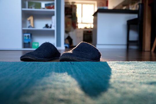 Close-up Of Shoes On Floor In House