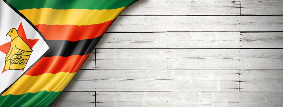 Zimbabwe flag on old white wall banner