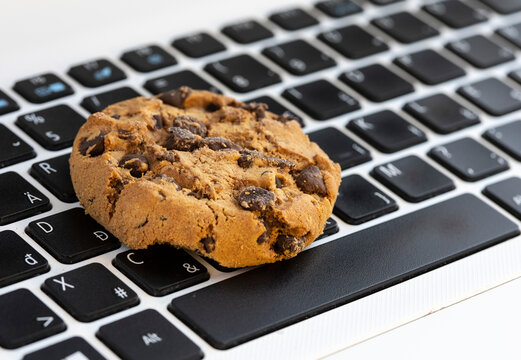 Chocolate on keyboard symbol of internet cookies