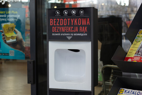 Katowice, Poland – March 20, 2021: Closeup of automatic disinfectant dispenser at Lidl grocery store.