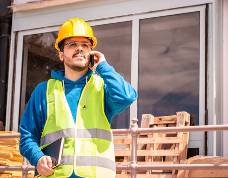 Latin male worker with hard hat and vest