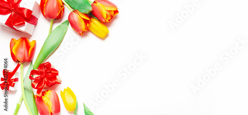St. Valentine or Mother's Day. Beautiful tulips, on light background. Day of birth. Greeting card.