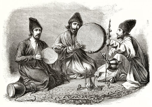 Persian musicians playing traditional percussion instruments crouched on a oriental carpet. Ancient grey tone etching style art by Duhousset, Le Tour du Monde, 1862