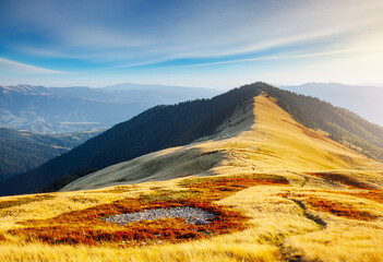 Wall Mural - Majestic panorama of mountains in sunny day.