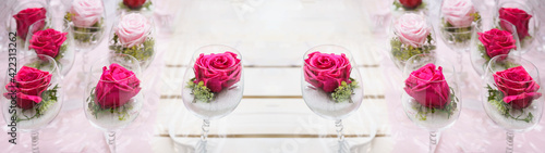 Classy festive decorative floral Wedding / Mother's Day / Birthday  background banner panorama greeting card template - Many pink blooming rosa roses in wine glasses on white vintage table