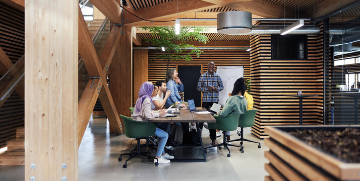 Diverse businesspeople smiling while having an office meeting