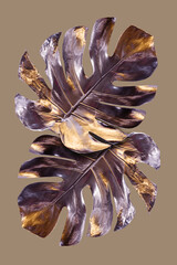 Monstera leaves painted in silver with gold flares. Minimalist luxury concept. Good for interior decoration pop-art poster.