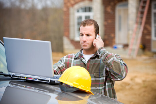 Construction: Checking Something with Manager on Phone