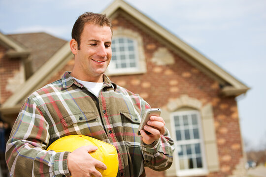 Construction: Builder Using Cell Phone