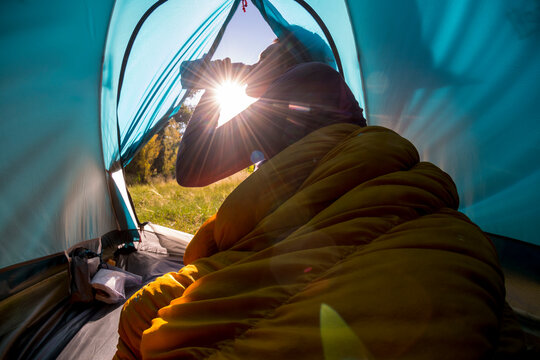 A woman camping in the Dominguez-Escalante National Conservation Area, Delta, Colorado.