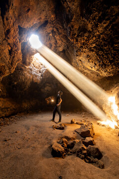 Mojave National Preserve, California: Light rays pass from the surface into the subterannean Cima lava tube.