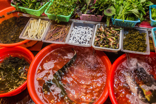 Various food items in front of a restaurant in Fenghuang Ancient Town, Hunan province, China