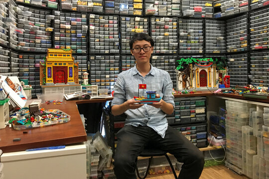 Hoang Dang, an industrial designer who loves Lego since he was a child poses in front of his pieces at his home in Hanoi, Vietnam