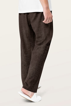 Man in lounge pants and slippers