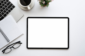 Mock up. Digital tablet blank white screen placed at table with coffee and in the office.