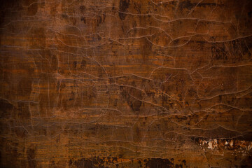 brown, yellow and black colors on a textured, cracked painted surface,  background