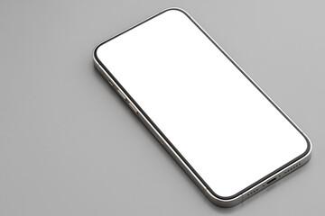 Fototapeta Modern smartphone with white screen on gray background obraz