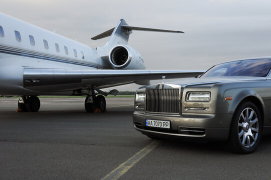 London, UK-7 MAY, 2020: Private executive airplane with limousine Rolls Royce Phantom luxury car shown together at international Heathrow Airport. VIP service at the airport. Business class transfer.