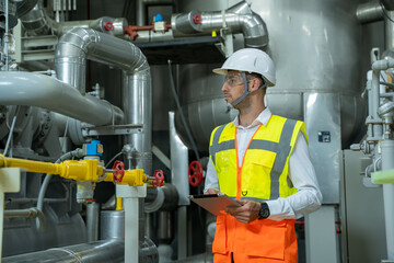Electrical engineer checking and maintenance equipment condenser Water pump in electrical energy distribution substation at industry factory.
