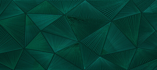 Abstract triangular dark green mosaic tile wallpaper texture with geometric fluted triangles background banner