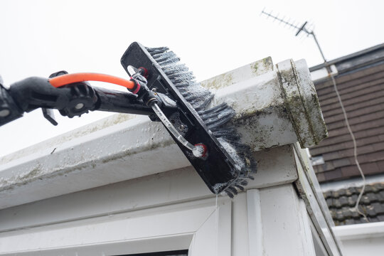 Cleaned white plastic pvc gutters and drain pipes that were blocked and full of green mould on the plastic fascias.  Blocked drains and guttering need cleaning and regular maintenance for drainage
