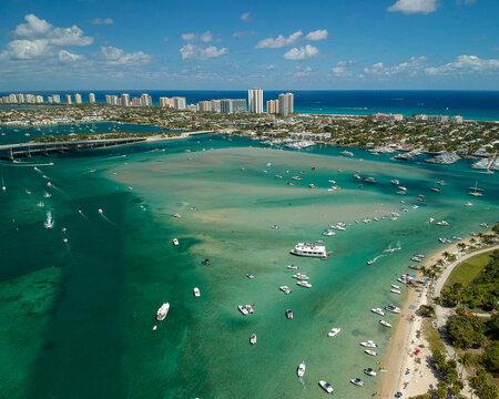 Peanut Island drone photography of boats at the sandbar and Singer Island near West Palm Beach, Florida, Palm Beach County