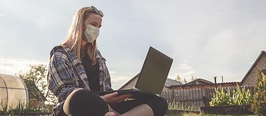 Coronavirus. Quarantine. Online training education and freelance work. Computer, laptop and girl...