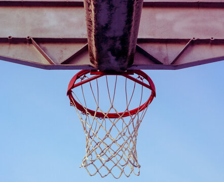 Neighborhood Basketball Hoops and Colorful Skies
