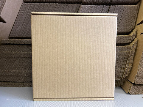 corrugated cardboard packaging for goods and food. square mailboxes made of cardboard.