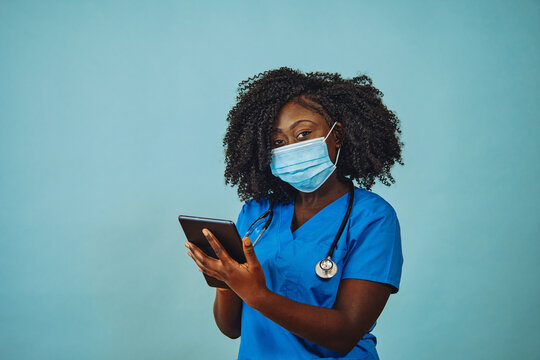 Nurse practitioner doctor with face mask, tablet and stethoscope