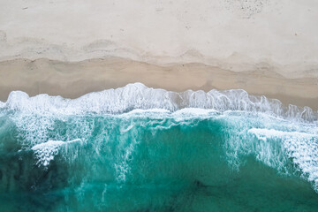Aerial view of beach and ocean with waves. Drone view of sea. Galicia, Spain.