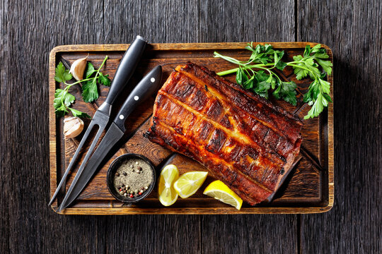 Barbecued Pork Loin Roast on a wooden board
