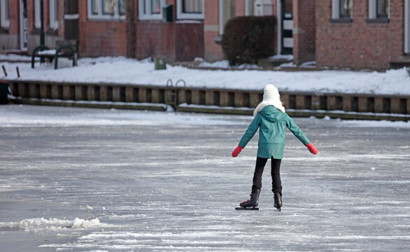 Child skating on natural ice, Netherlands