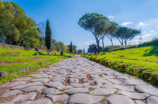 """Rome (Italy) - The archeological ruins in the Appian Way of Roma (in italian: """"via Appia Antica""""), the most important Roman road of the ancient empire, named """"regina viarum""""."""