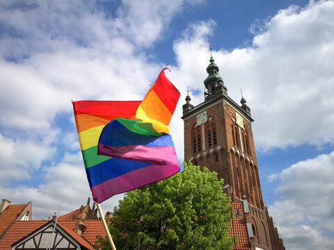 rainbow flag and catholic church