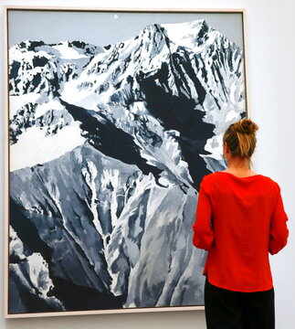 """A person looks at the painting """"Himalaja"""" by German painter Gerhard Richter at the Kunsthaus Zurich art museum in Zurich"""