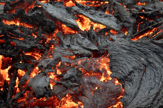 Flowing  lava close up. Volcano eruption at Fagradalsfjall, Iceland.