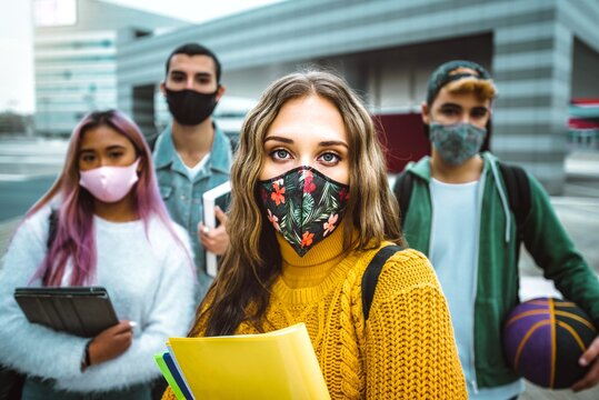 Portrait of a group of multiracial people covered by face masks - New normal lifestyle concept with students going to school - Vintage filter
