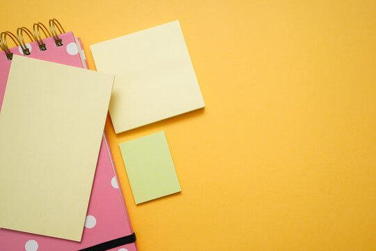 Colorful office supplies on yellow background