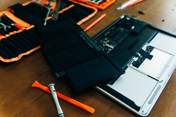 Dismantle laptop with tools and battery, display, hard disk and other components. Wall mural