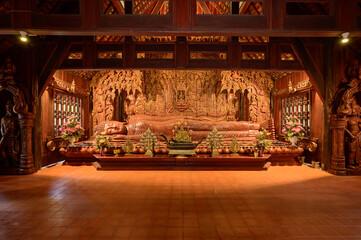 Fototapeta The Wooden Reclining Buddha of Wat Luang Khun Win in Chiangmai Province
