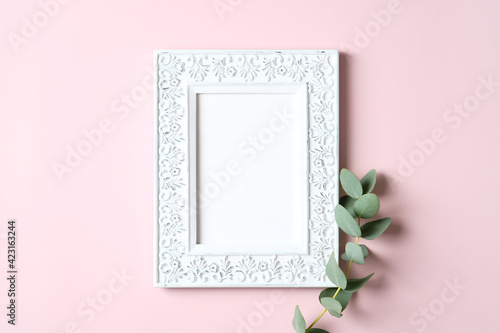 Vintage picture frame mockup and eucalyptus leaf on pink background. Mother's Day greeting card template.