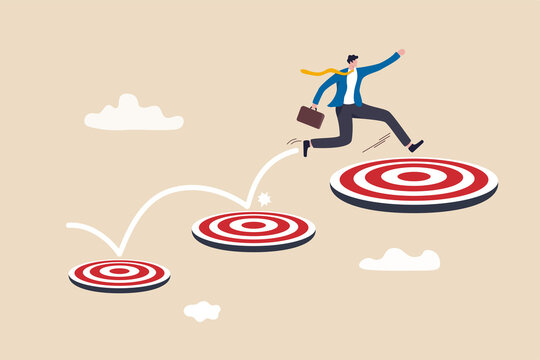Aspiration and motivation to achieve bigger business target, advancement in career or business growth concept, smart businessman jumping on bigger and higher archery bull's eye target.