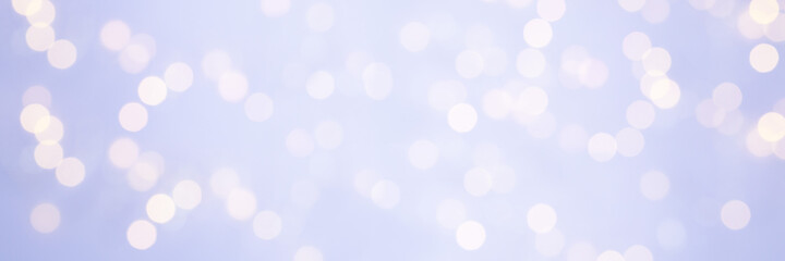 青紫の淡い背景に暖色系の光の玉